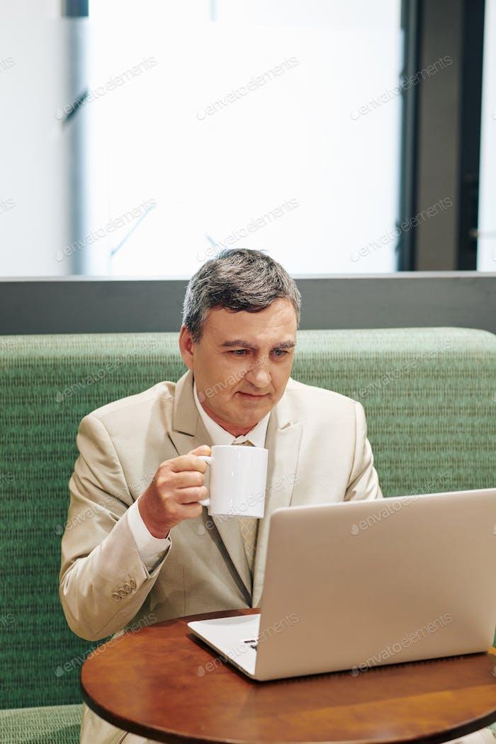Caucasian Businessman Drinking Coffee