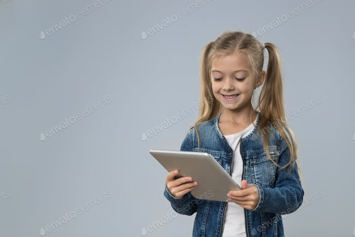 Little Teenage Girl Using Tablet Computer, Small Kid Happy Smiling Child