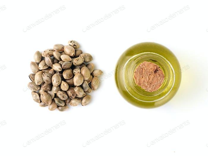 Hemp seeds and hemp oil isolated, top view