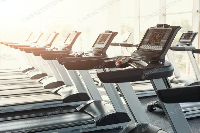 Modern gym interior equipment, treadmill control panels for card
