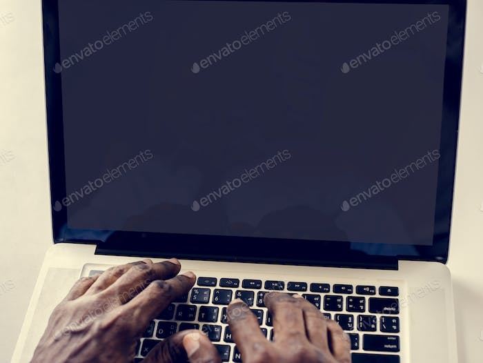 Hands working typing on laptop