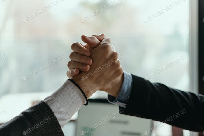 Two business men celebrating a deal
