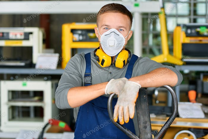 Young Workman in Protective Mask