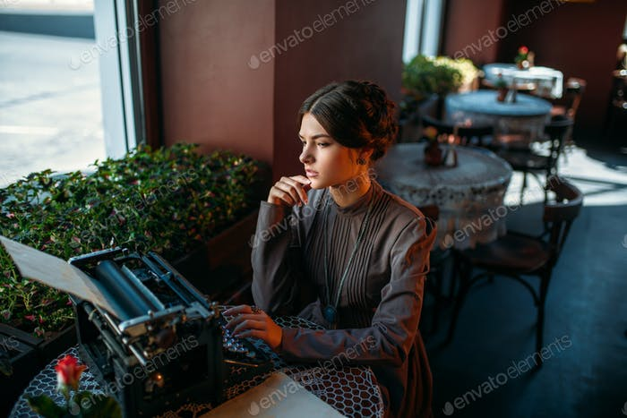 Portrait of beautiful young woman in cafe