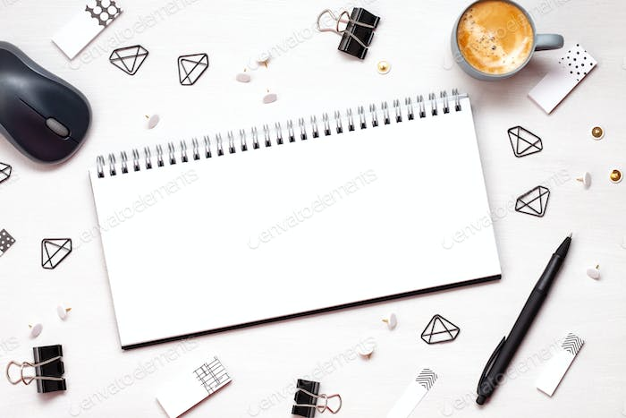 Overhead view to various office supplies. Flat lay with mockup planner