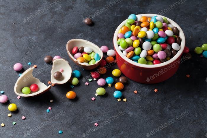 Colorful candies and chocolate egg