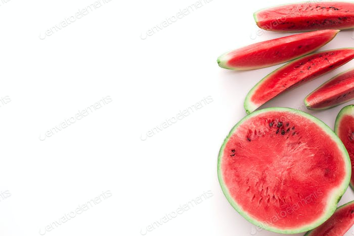 Cut fresh red watermelon on white background