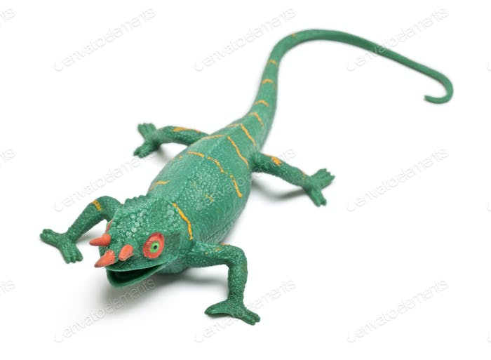 Chameleon toy in front of white background