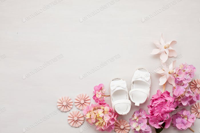 Cute newborn baby girl shoes. Baby shower, birthday, invitation, greeting card