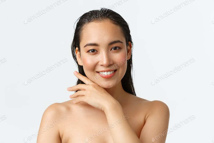 Skincare, bodycare, beauty and bath concept. Close-up of sensual attractive asian woman standing