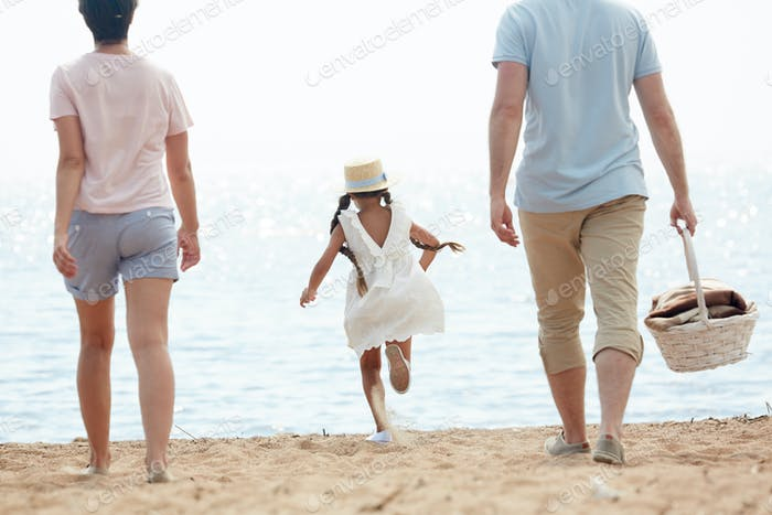 Happy Girl Running to Water