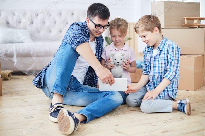 Loving Family Enjoying New Apartment