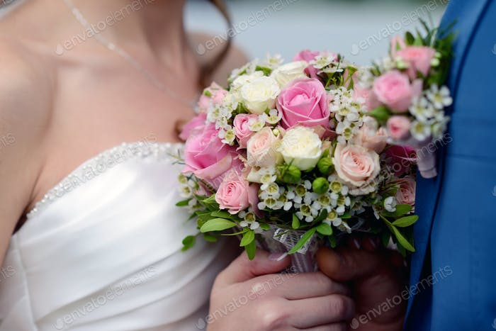 Wedding couple with bouquet. Female and male portrait