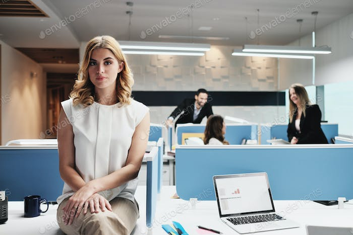 Portrait Worried Business Woman Looking At Camera In Coworking Office