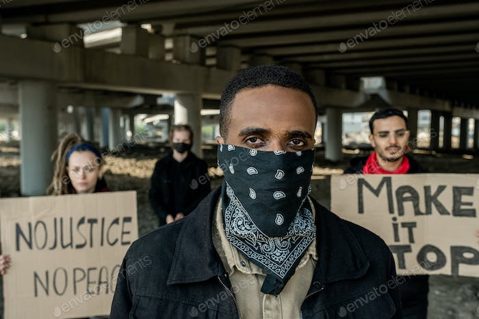 Black man participating in demonstration