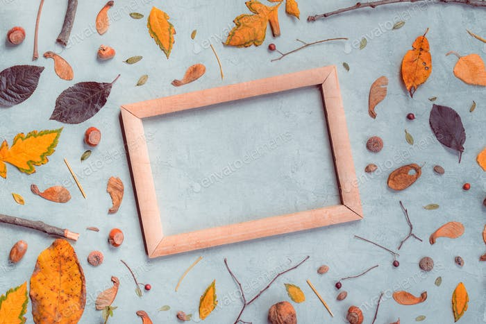 Autumn decoration and blank picture frame flat lay top view