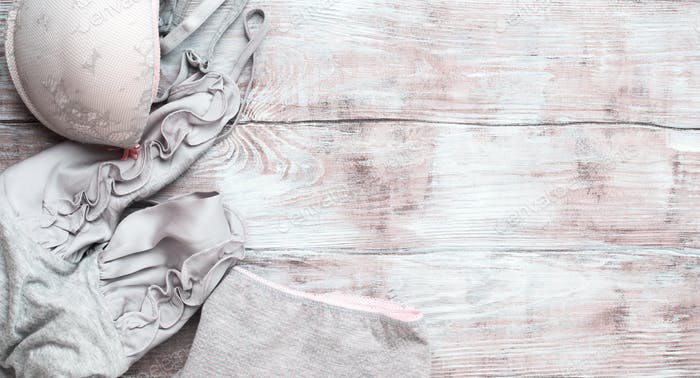 Gray woman lingerie set on wooden background