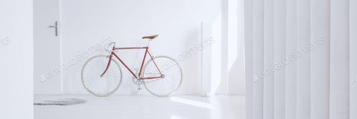 Red vintage bike in apartment