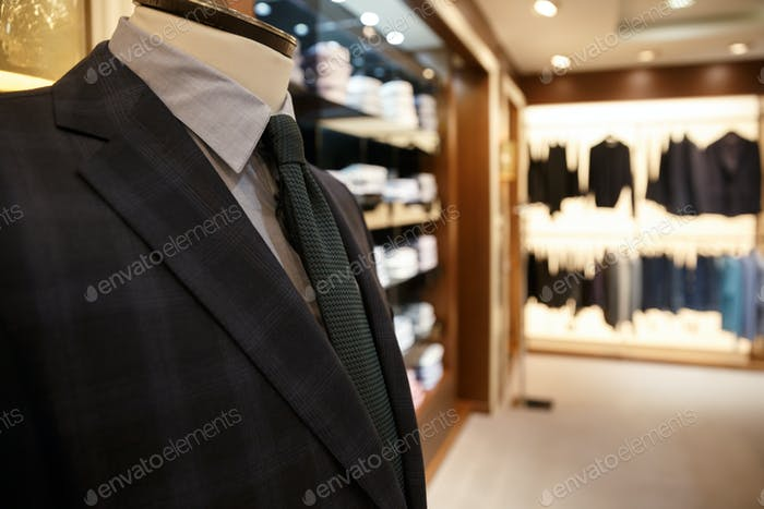 Close up shot of man suit jacket on hanger