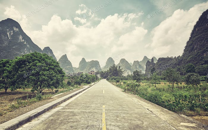 Retro stylized picture of a countryside road, China.
