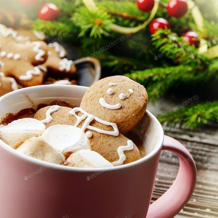 Pink mug with hot chocolate marshmallows and gingerbread man clo