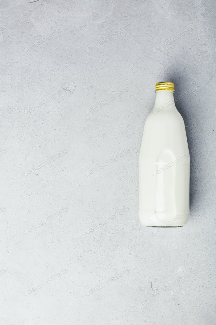bottle of milk on grey concrete background