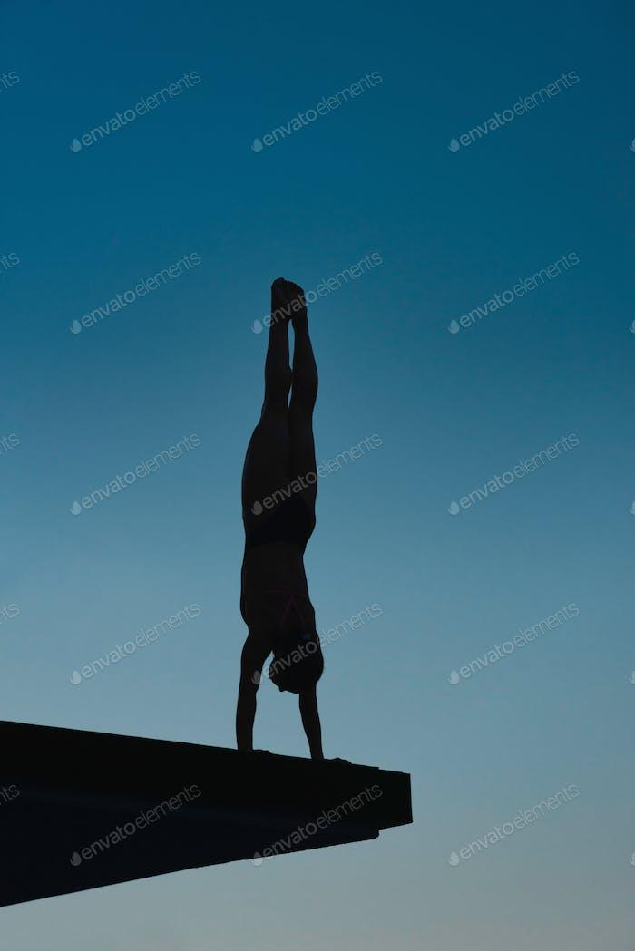 Handstand diver on board
