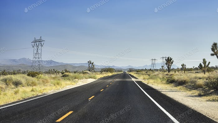 Panoramic picture of a deserted countryside highway, USA.