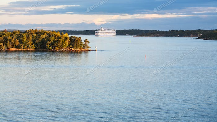 view of cruise liner and sea coastline in sunset