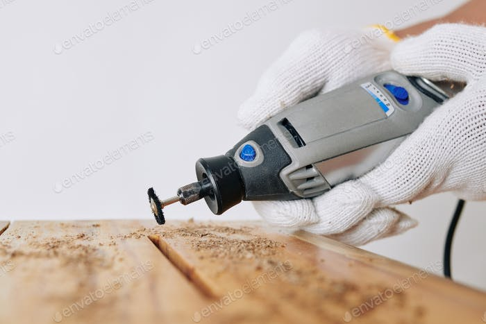 Carpenter using rotary hand tool