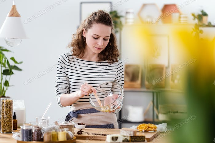 Vegan woman mixing natural ingredients