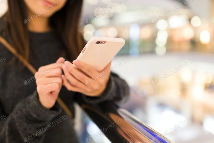 Woman working on mobile phone