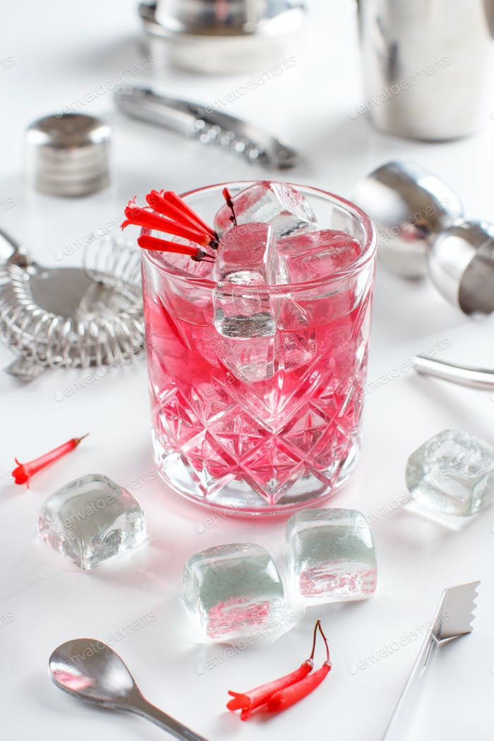 Cosmopolitan cocktail in a glass decorated with pink flowers
