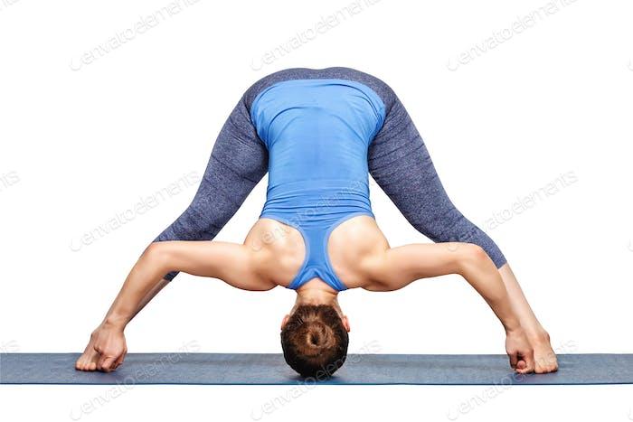 Woman practices Ashtanga Vinyasa yoga asana Prasarita padottanas