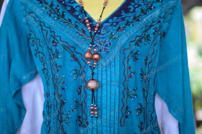 Clothes that are on the dummy and necklaces