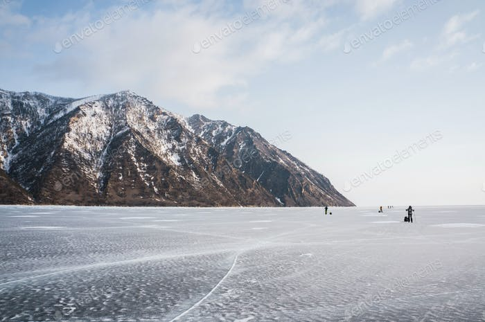 Scenic View of Frozen River With Snowy Mountains in Winter, Russia, Lake Baikal