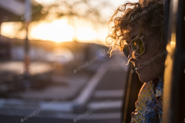 beautiful light and young woman with curly hair rportrait