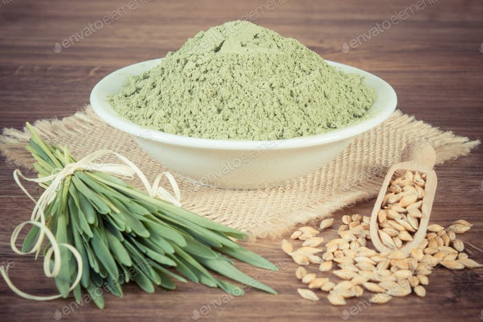 Vintage photo, young powder barley, barley grass and grain on jute canvas, wooden background