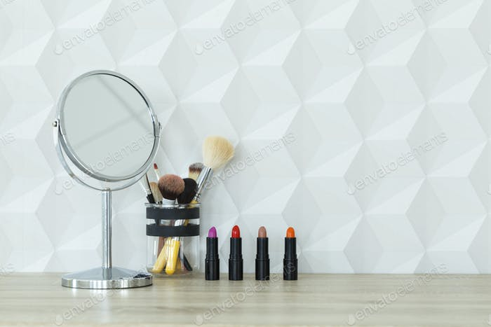Lipsticks, mirror and brushes