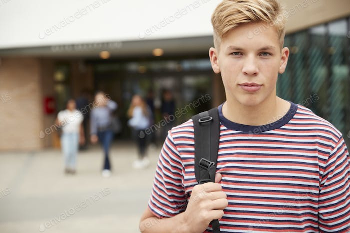 Portrait Of Serious Male High School Student Outside College Building
