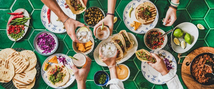Friends feasting at home taco party with beef tortillas
