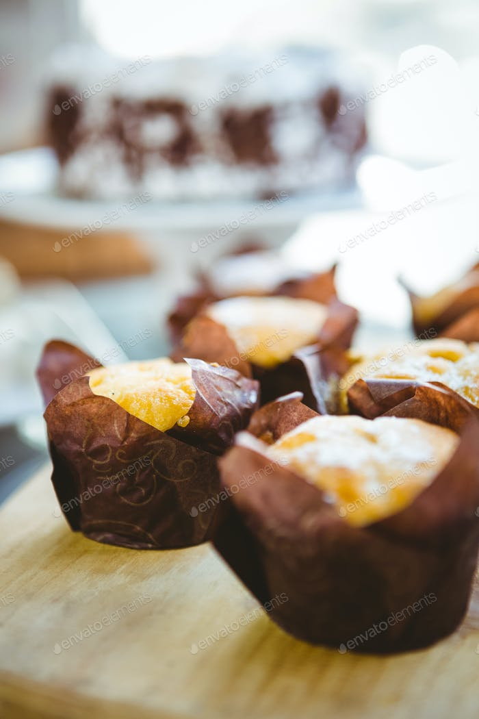 Muffins in a bakery on a sunny day