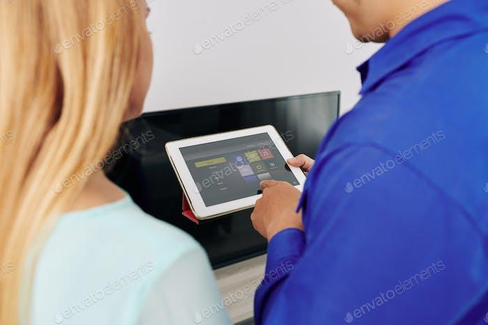 Technician showing smart home app