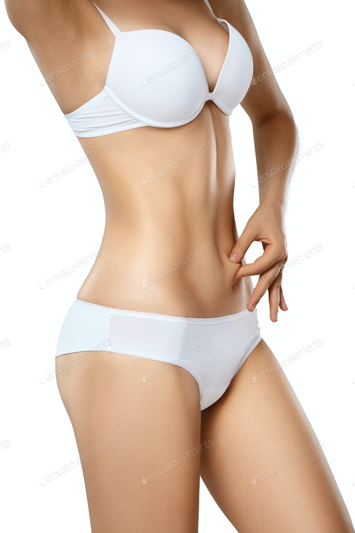 Unrecognizable woman in underwear testing fat layer on tummy
