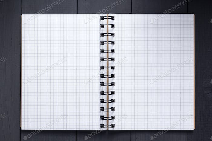 notepad or notebook at black wooden background surface table, to