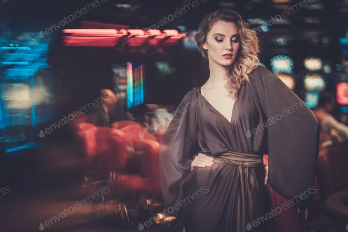 Beautiful woman in a luxury casino interior