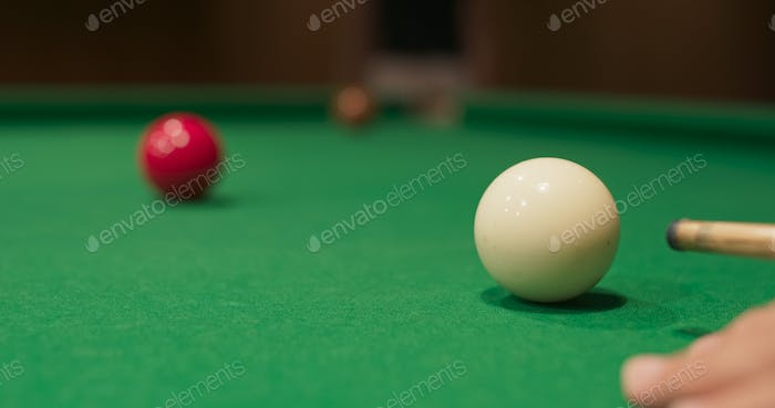 Snooker shooting on snooker table