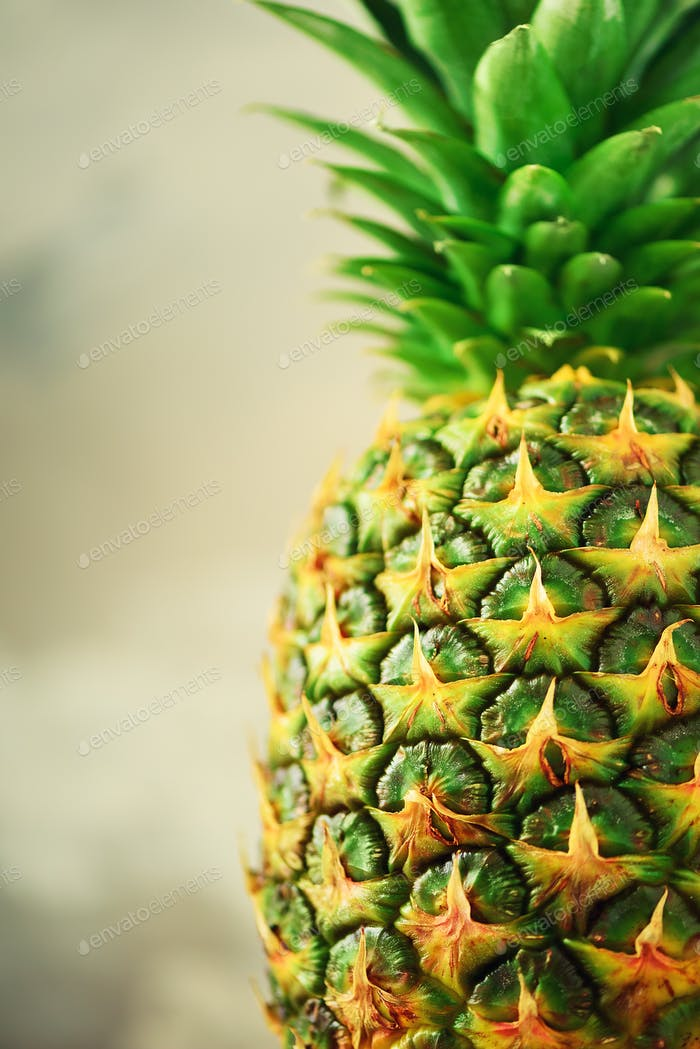 Pineapple fruit background. Close up of tropical pineapples texture. Summer, holiday concept. Raw