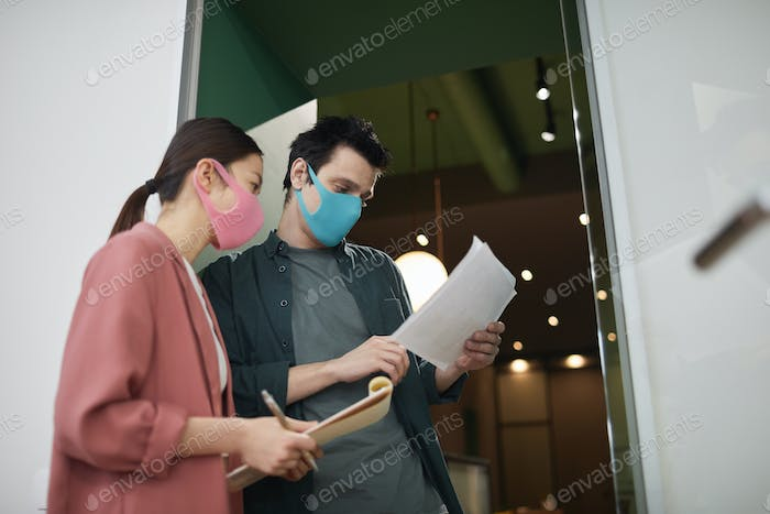 Business colleagues working during epidemic