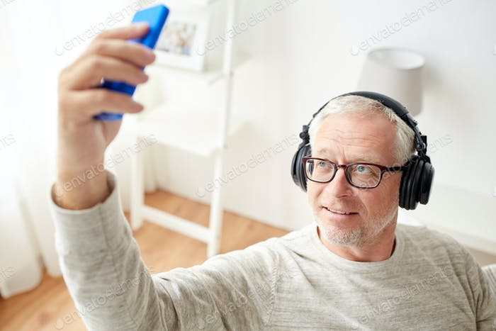 senior man with smartphone and headphones